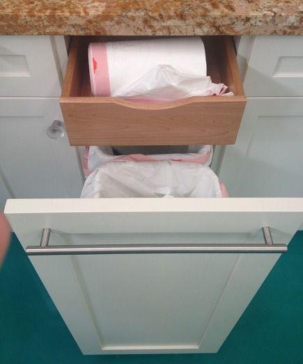 hidden trash bag storage via Atticmag. I have tried to find the ...