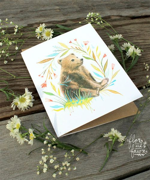Flor and Fawn by friends Katie Daisy & Karen Eland featuring watercolor paintings of animals amidst floral wreaths and colorful blossoms.