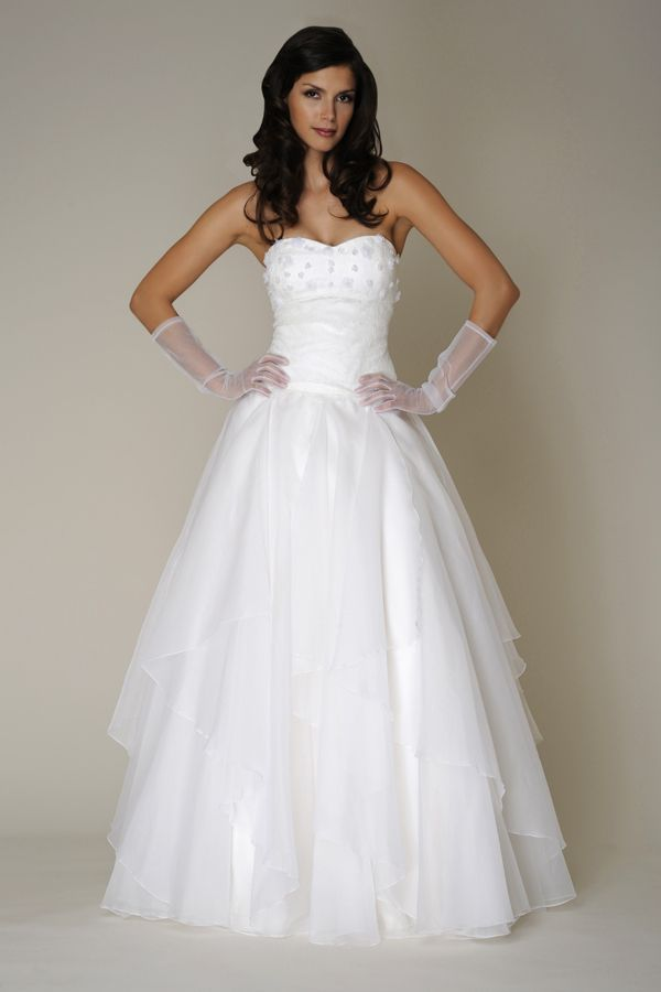 Strapless sweetheart gown with chantilly lace bodice and cascading silk organza skirt.