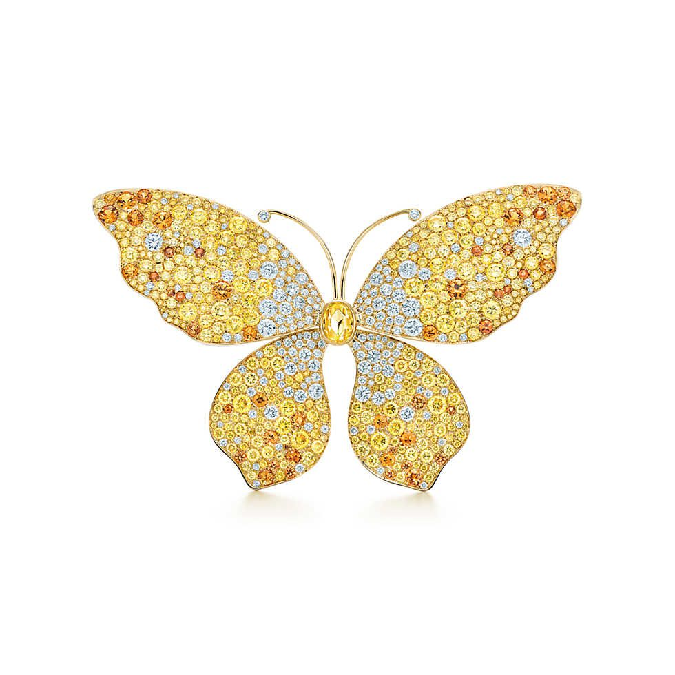 Brooch in 18k gold with diamonds and spessartites. | Tiffany & Co.