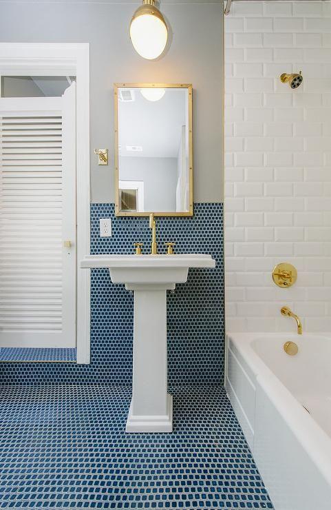 Kohler Tresham Pedestal Sink.Simple Brass Light Pendant Hangs Over A Kohler Tresham