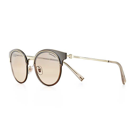 b2e4be973e9 Tiffany T round sunglasses in pale gold-colored metal.