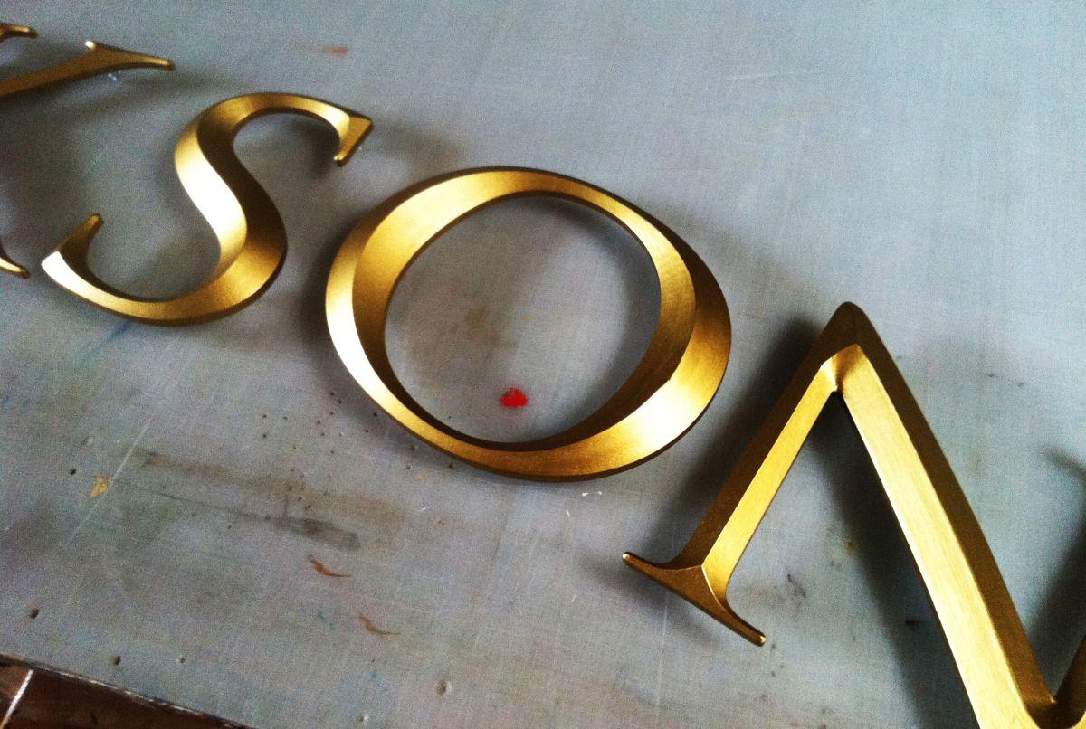 Cutout Prismatic Gold Letters Wayfinding Signage Design Gold Letters Signage Design