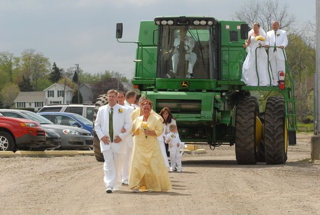 """An outdoor farmer's wedding at the Eagle Community Center.  Love the John Deere """"chariot"""" the bride and her father rode in on.  Very unique and awesome wedding. #HolmesPhotography"""