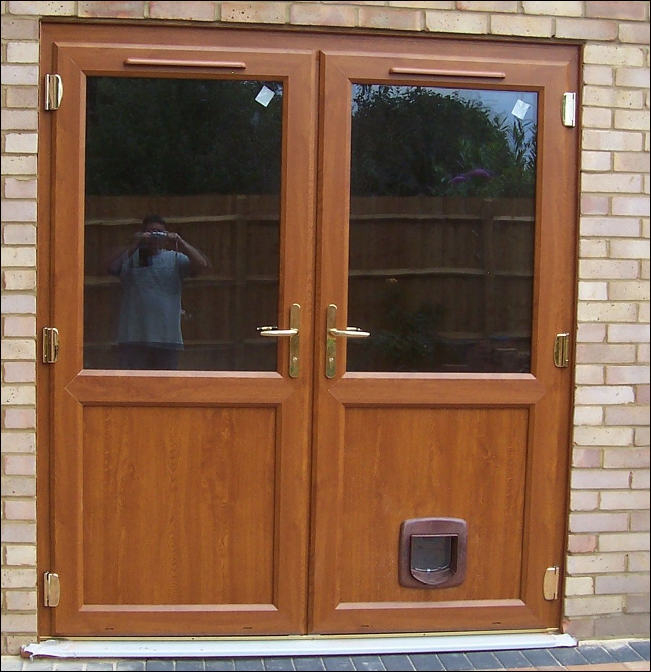 Pvc Double Doors Complete With Cat Flap In Light Oak Supplied And
