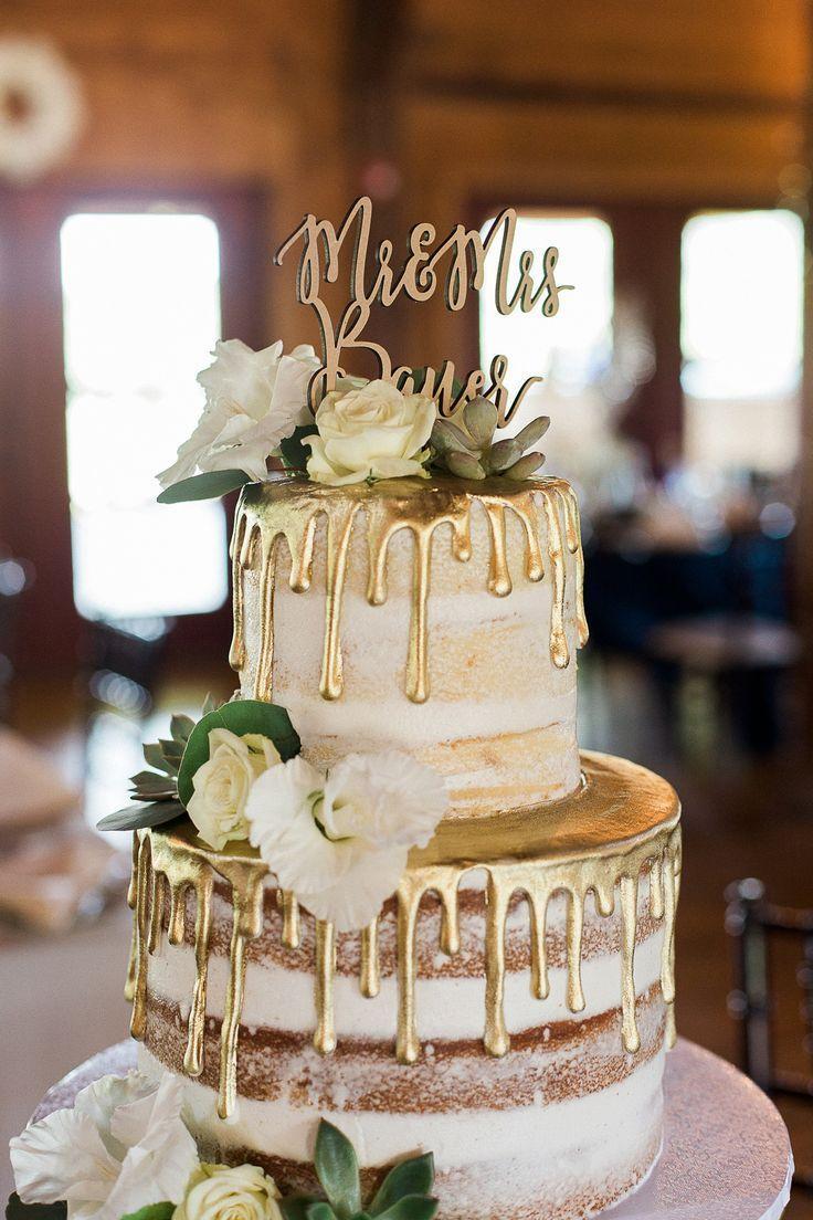 Gold Drip Hochzeitstorte mit Blumen