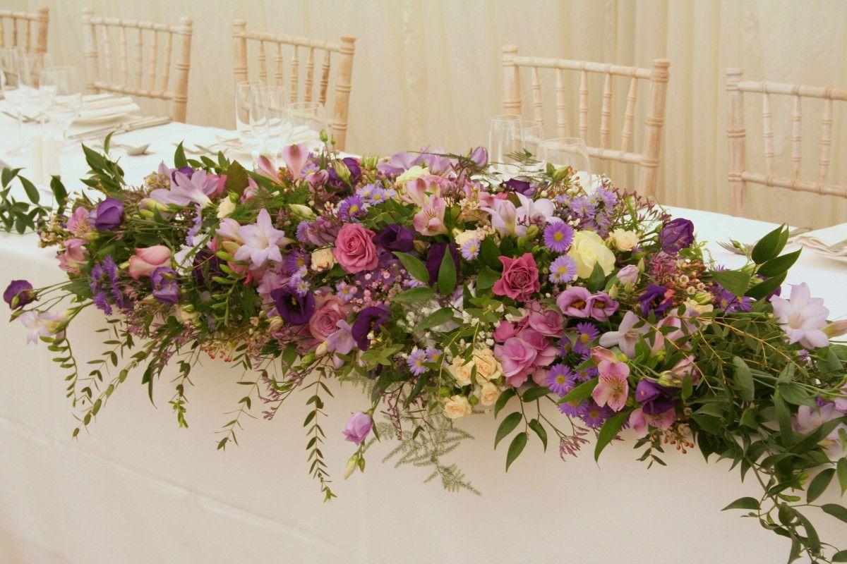 Pink purple and lilac top table arrangement wedding flowers pink purple and lilac top table arrangement izmirmasajfo