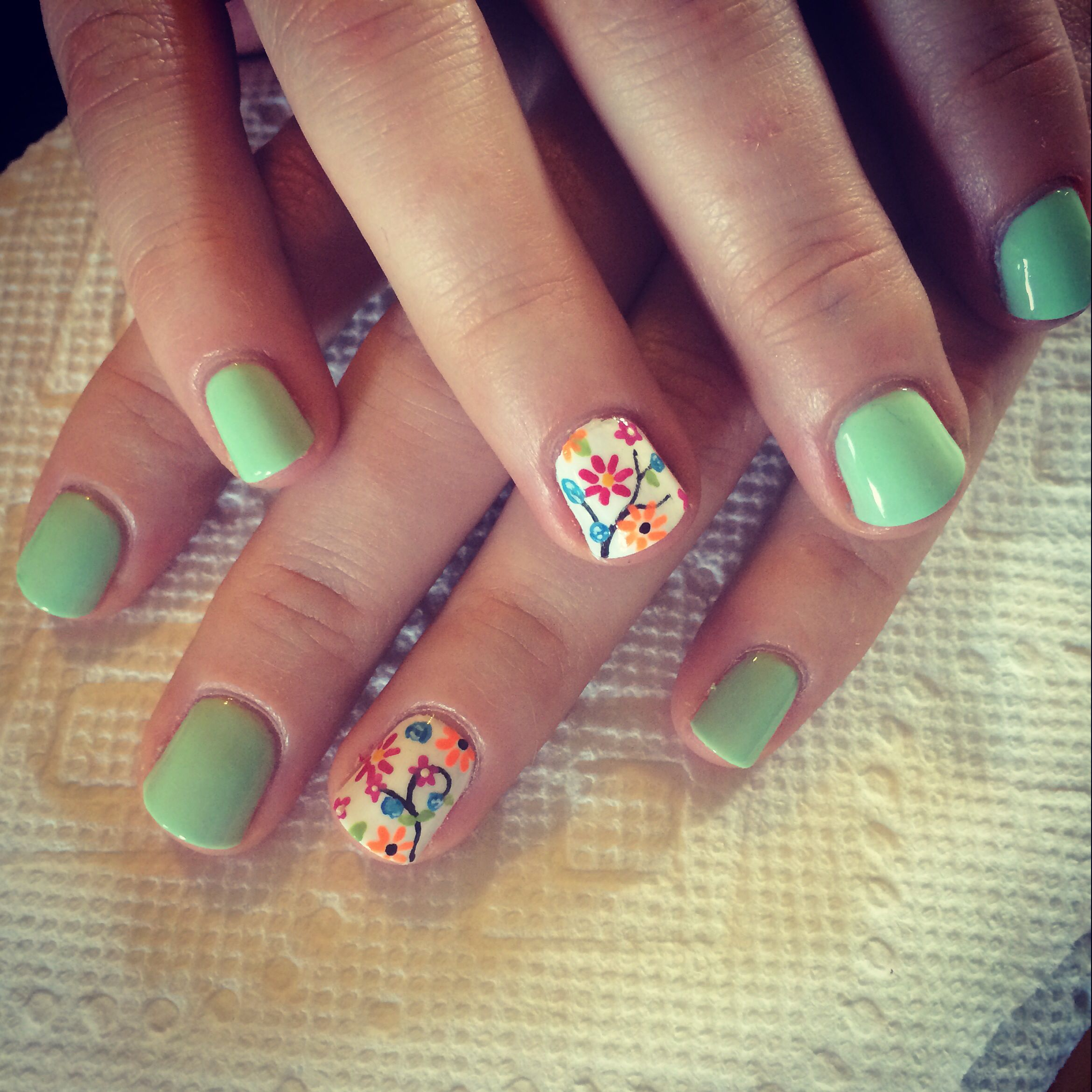 mint green nails with floral nail