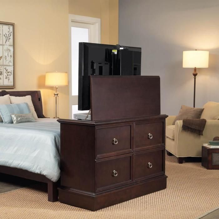 Flat screen tv cabinets with lifts are a great way to for Tv lift consoles for flat screens