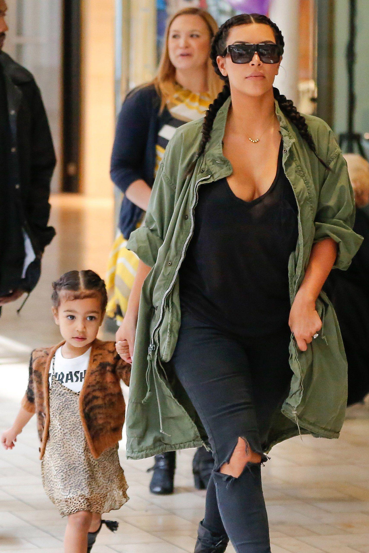 Kim Kardashian unveils jaw-dropping curves in plunging