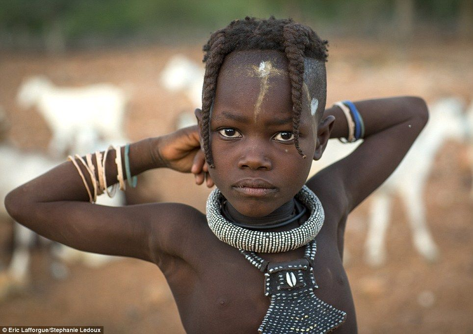 Fascinating! The Himba people of Namibia and their elaborate hair styles. very beautiful.
