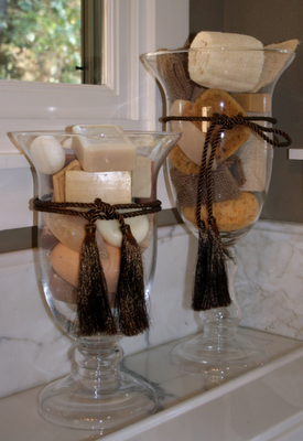 Vases filled with beautiful bath soaps and sponges like for Bathroom decor vases