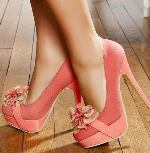 The color is gorgeous. Heel is amazing. Not a huge fan of flowers on the toe of a shoe but these would definitely turn heads. #heels
