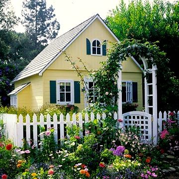 picket fence and trellis with vines and flower garden surrounds