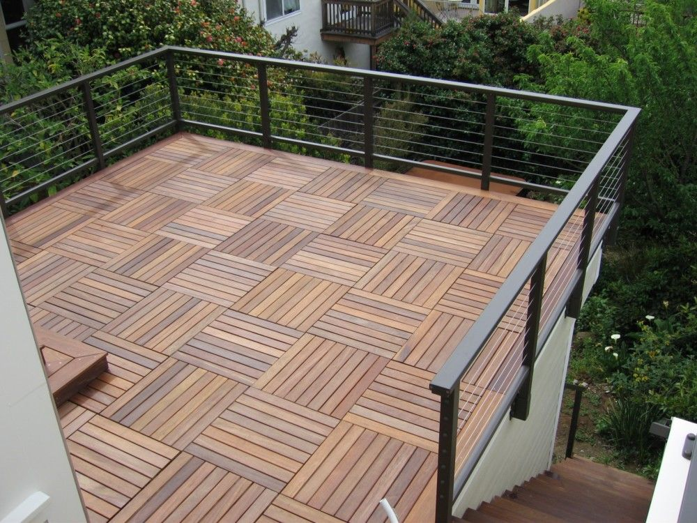 Wood deck over roof railing on the face of wall and not for Garden decking banister