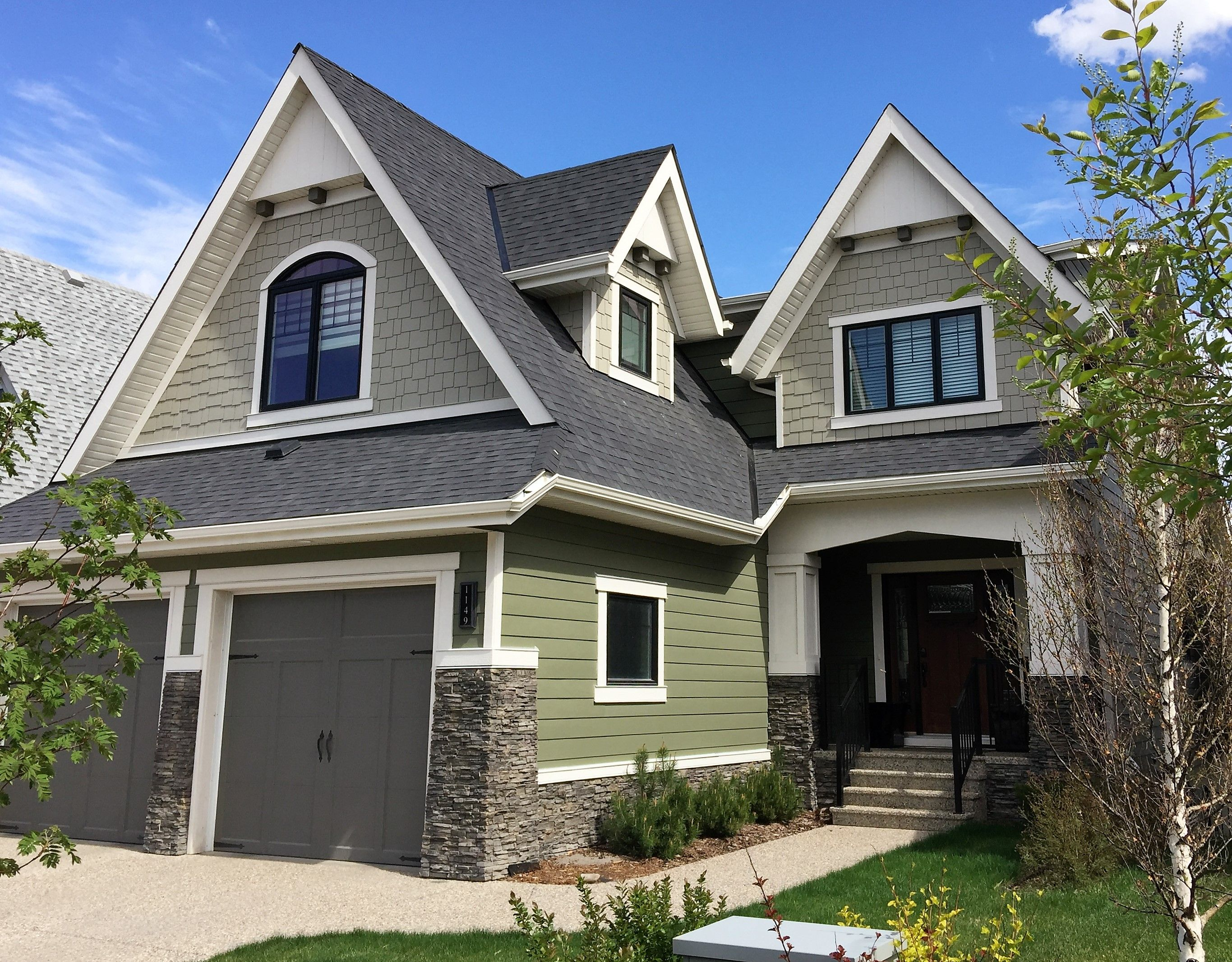 Steep Roof Pitches Craftsman Inspired Exterior Colours And Lovely Dormer On This Crafstman Home Crafst House Exterior Traditional Architecture House Styles