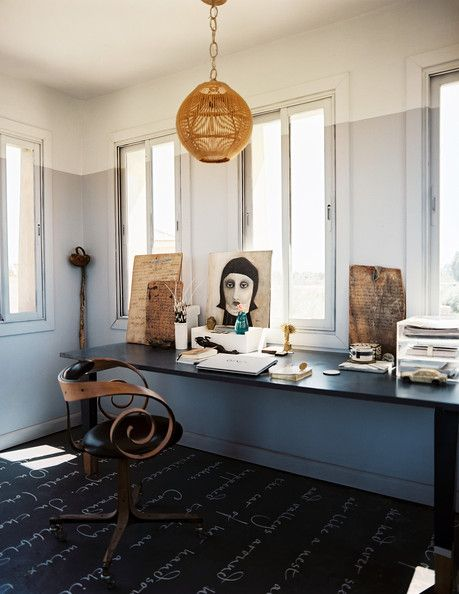 Unique Chair - An office space with a long black desk