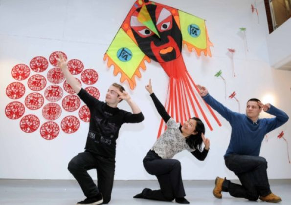 Sam Green, Feixia Yu and Dom Wylor-Owen at the Chinese Kite Exhibition at Uclan. Sam and Dom are studying Chinese Language. Feixia is  Director of the Uclan Confucius Institute.
