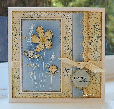 handmade birthday card ... taupe and blue ... paper pieced flowers on white embossed stems ... edge cut lacy scalloped  edges . knotted ribbon  ... square format ... delightful card!!