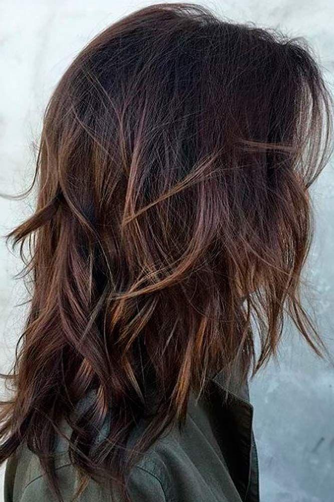 langt etageklippet hår