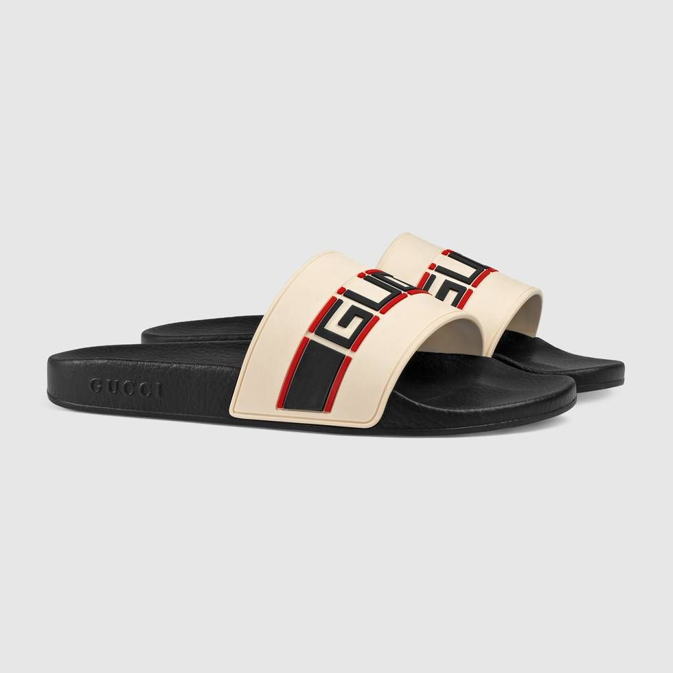 58bd56bf76f23 Shop the Gucci stripe rubber slide sandal by Gucci. A new distinct detail  of the House