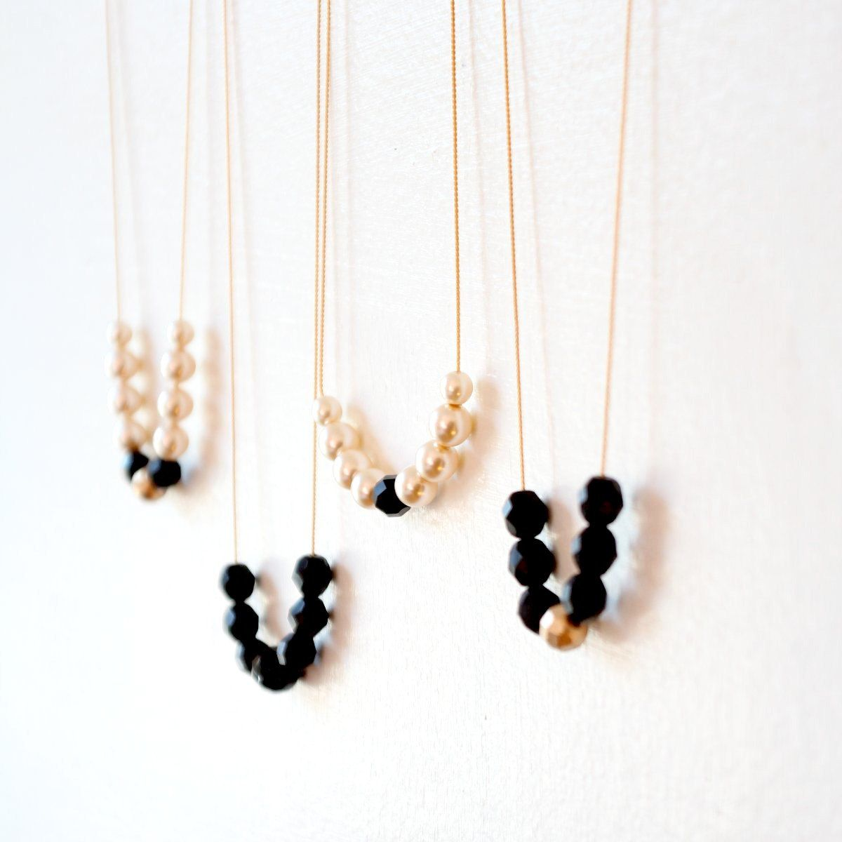 Pearl Black and Gold Bead Strand Necklaces. $32.00, via Etsy.