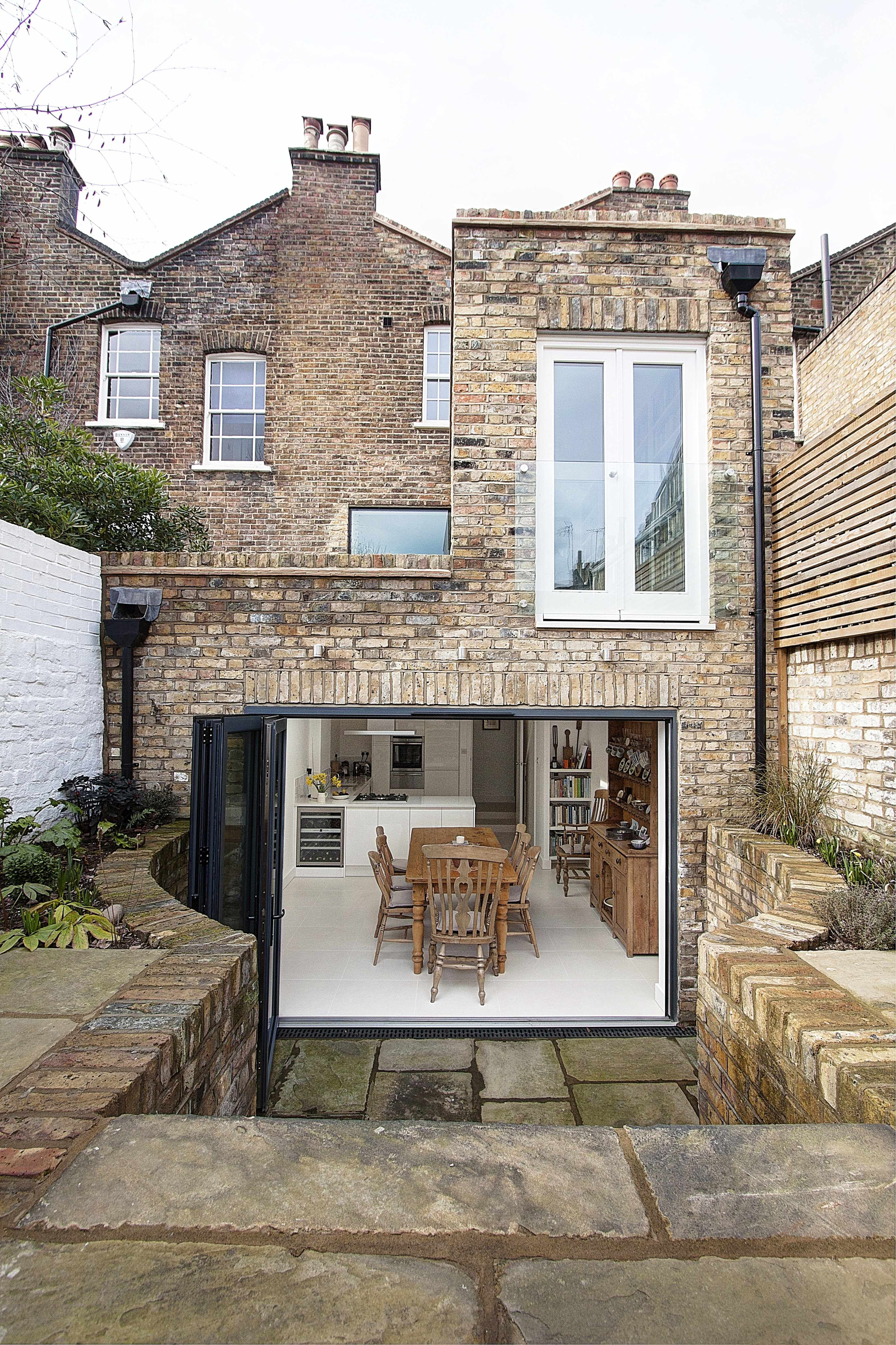 Folding doors and the use of brick helps to connect the dining ...