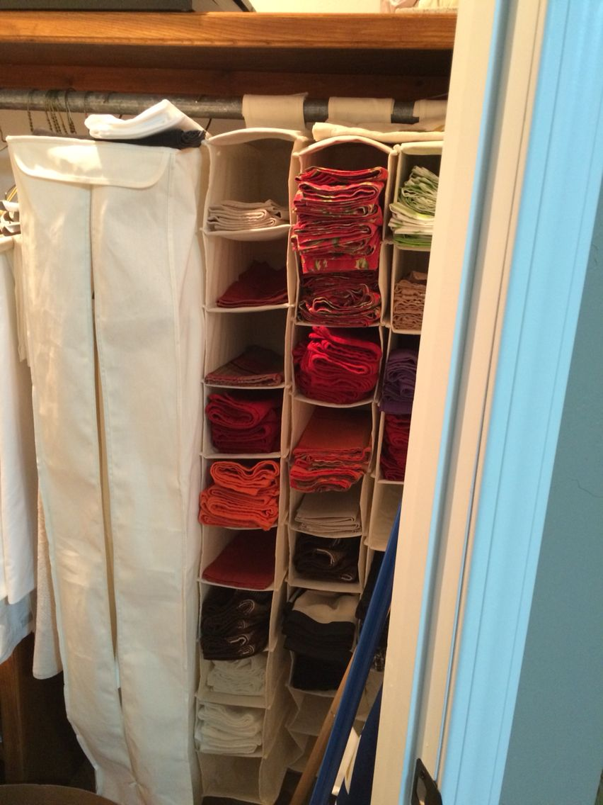 Genius use a hanging shoe rack to store table linens kitchen