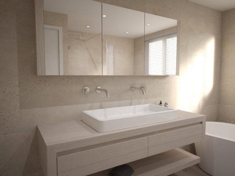 Badkamer ontwerp met ligbad regendouche toilet en badmeubel
