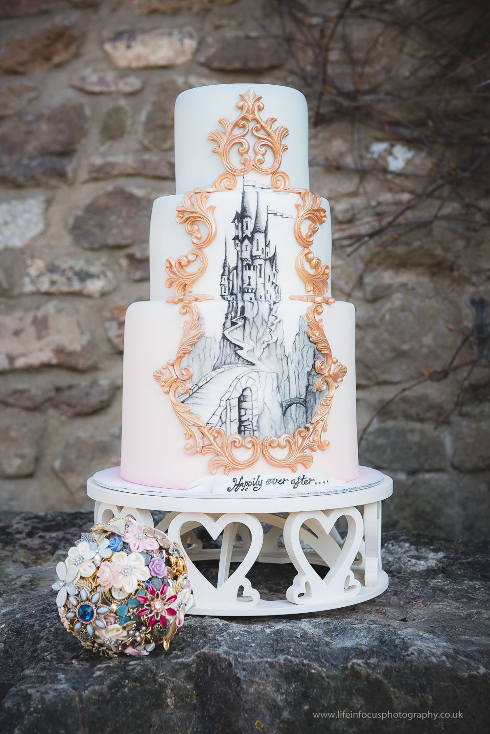 Fairytale castle wedding cake handpainted design with gold detail