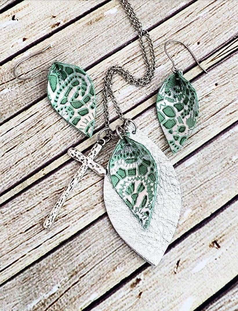 Photo of Items similar to Leather Jewelry, Leather Necklace, Leather Earrings, Silver and Green Jewelry, Cross Necklace, Womans Gift, Cross Jewelry, Jewelry Set on Etsy