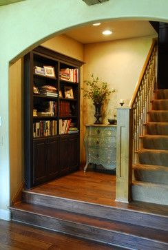 "This is a cool idea.  The elevation change and tucked in bookcase adds some depth to the basement. Most basements seem to ""flat"".  Jason"