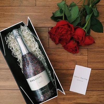 Glitter champagne bottle benefitting One Hope organization