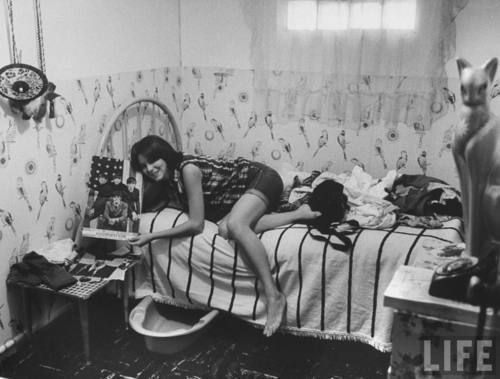 Teenage girl in her room showing off her beatles poster for Beatles bedroom ideas