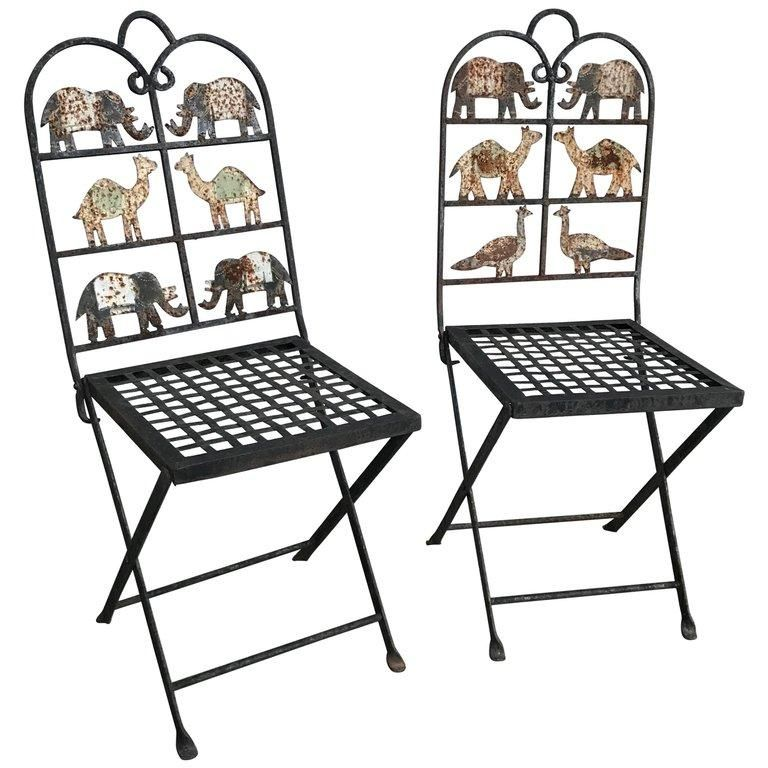 A Whimsical Pair Of Wrought Iron Folding Garden Chairs With