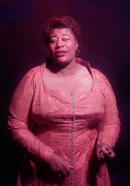 "Caption from LIFE. ""Ella Fitzgerald, who sings love ballads daintily, can roar like a trombone through a jazz classic."""