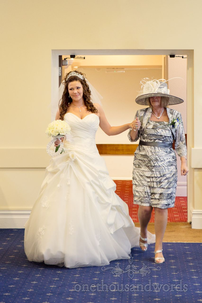 Bride and mother of the bride enter Bournemouth Hotel wedding ...