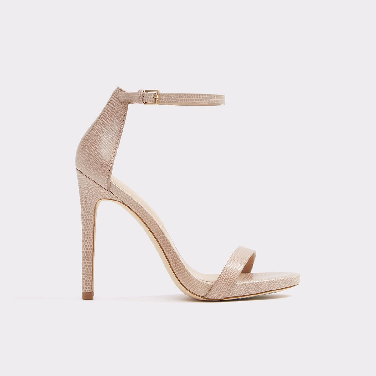 debc9c10814 Caraa A timeless bare-all ankle-strap high heel sandal that stands the test  of time. From wedding parties to date night to office wear