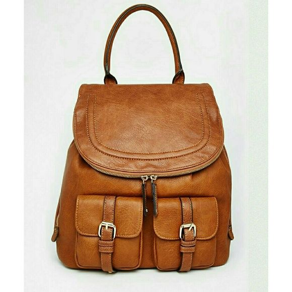 629a38d25e7 AlDO Brown Faux Leather Backpack Brown Tan Backpack With Top Handle And  Double Pockets. Side zippers expand backpack. Top has magnetic button to  keep shut.