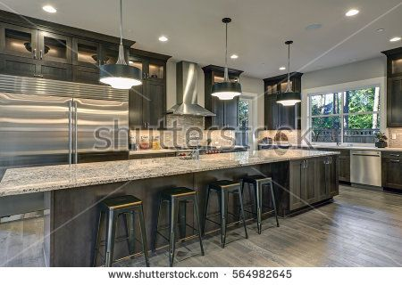 Modern Kitchen With Brown Kitchen Cabinets Oversized Kitchen Island With Bar Stools Granit Modern Kitchen Granite Modern Kitchen Island Modern Kitchen Design