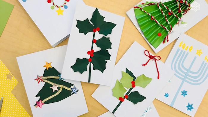 ▷ 1001 + suggestions de bricolage de Noël maternelle créatif #sapindenoeloriginal realisation-carte-de-voeux-noel-original-feuille-de-papier-blanc-avec-motif-hou-sapin-de-noel-chandelier-en-papier-coloré-décoration-de-noel-à-fabriquer-en-papier #deconoelmaternelle