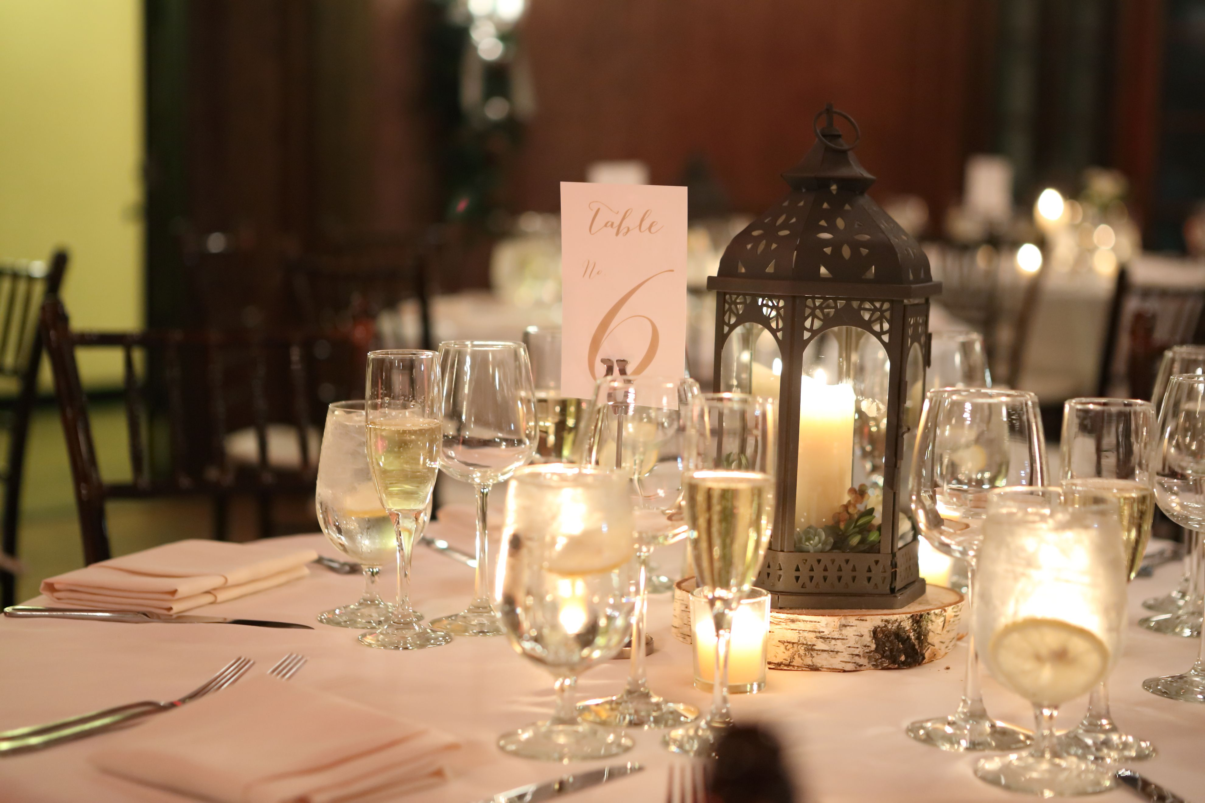 winter wedding centerpiece with lanterns and candles at willowdale estate topsfield ma willowdaleestate