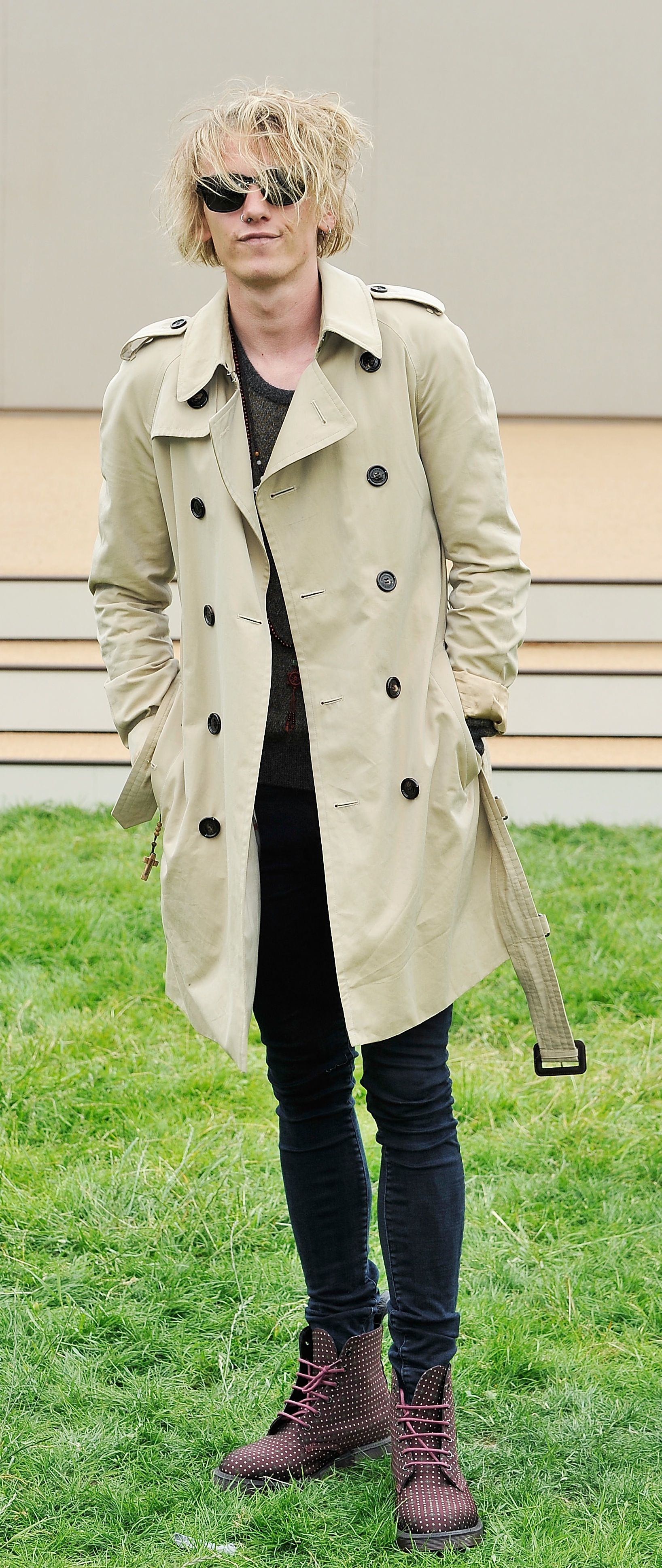 c8e9ebfbea5 British actor Jamie Campbell Bower wearing a Burberry trench coat outside  the Burberry Prorsum Menswear show