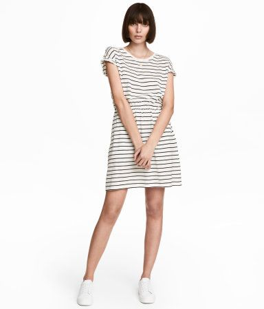 b668be6ba7be8 Dark blue/striped. Short-sleeved dress in slub jersey with elasticized  waistband and side pockets.