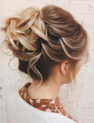 A Messy Bun Is A Simple Updo With An Elegant Look Messy Hairstyles Bun Hairstyles Prom Hair Updo Elegant