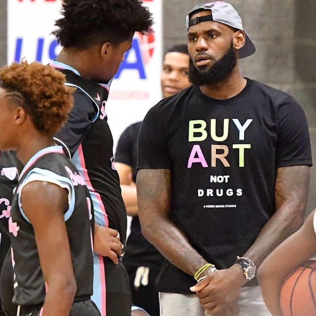 85059402301 LeBron James is taking his dad style to the next level with this  Buy Art  Not Drugs  shirt   nba