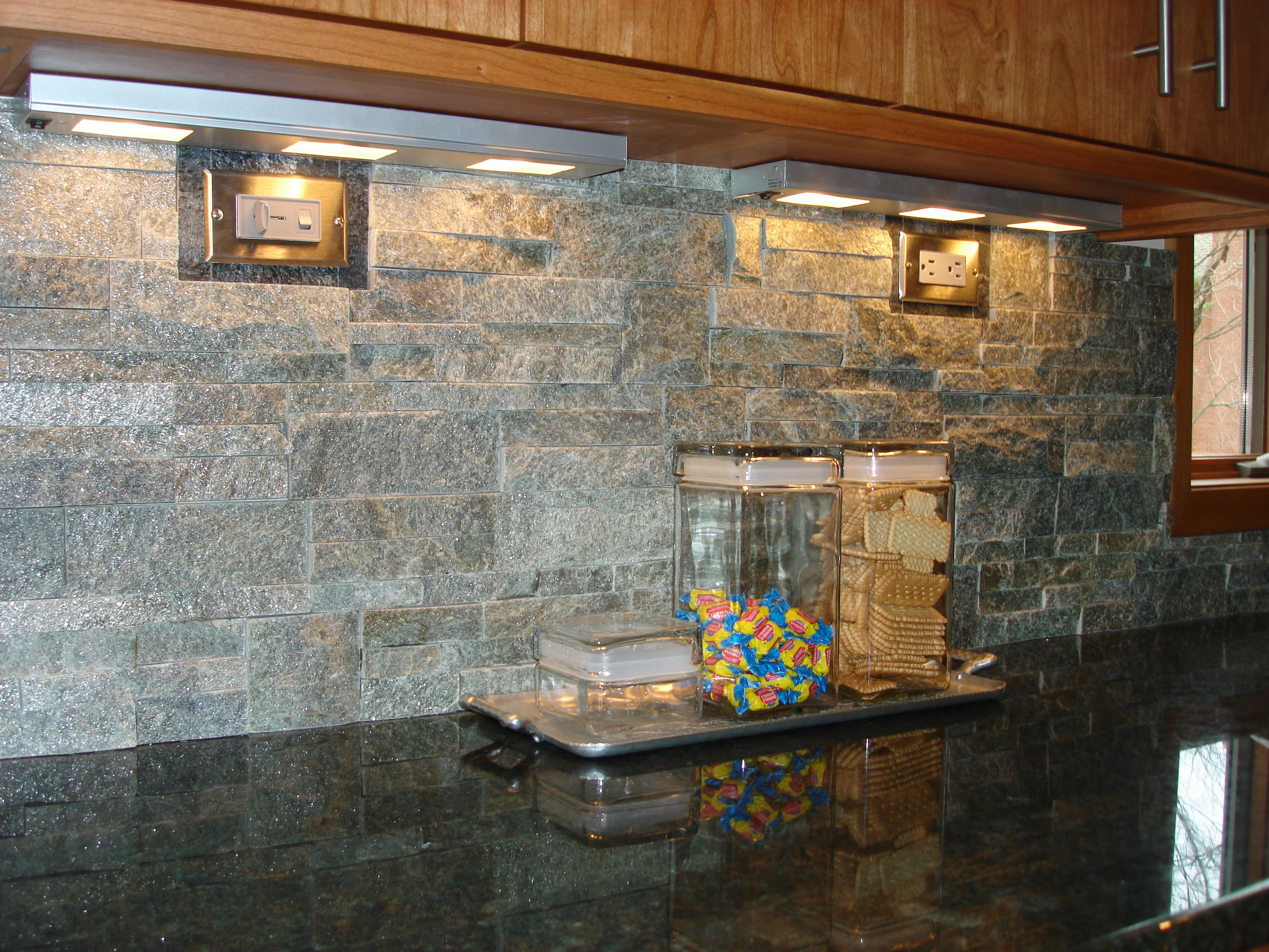 A stacked stone backsplash is a nice contrast with granite ...