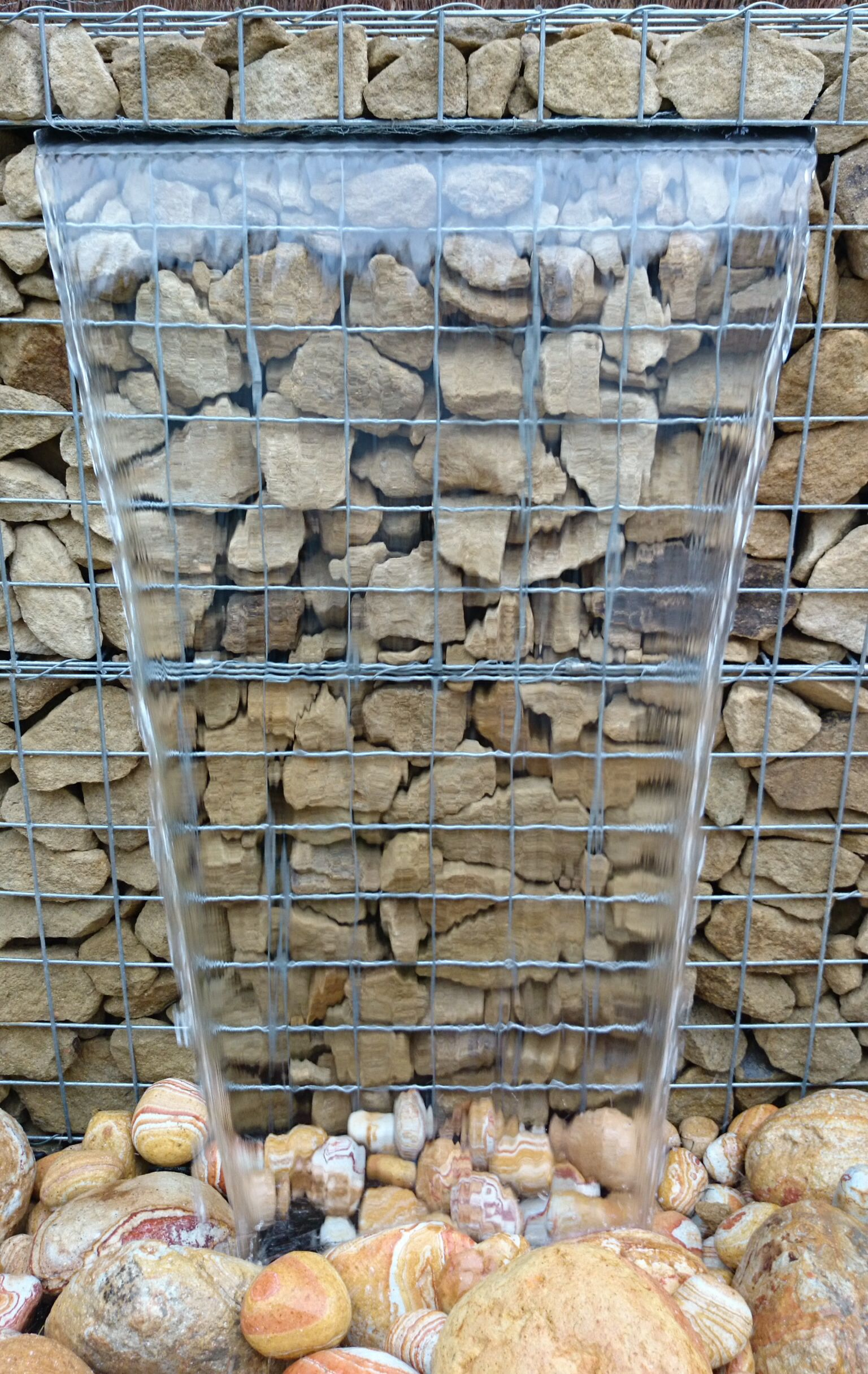 close up of gabion water feature  u2026