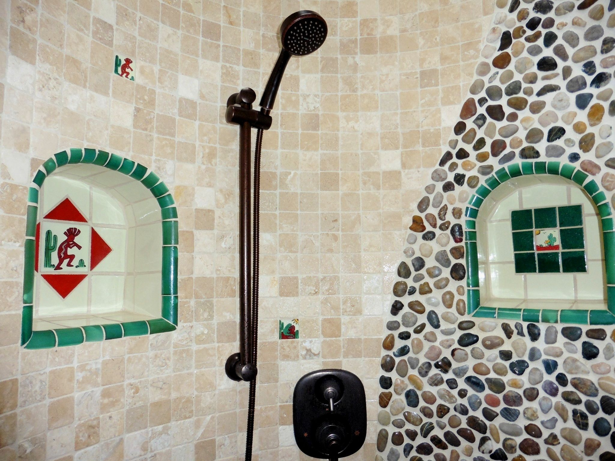Stone shower with Mexican tile niches.   Kristi Black Designs ...