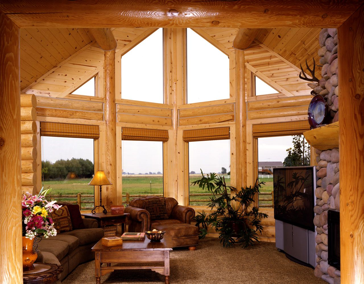 fabulous log home interior decorating idea for living room with brown sofas brown table - Log Homes Interior Designs